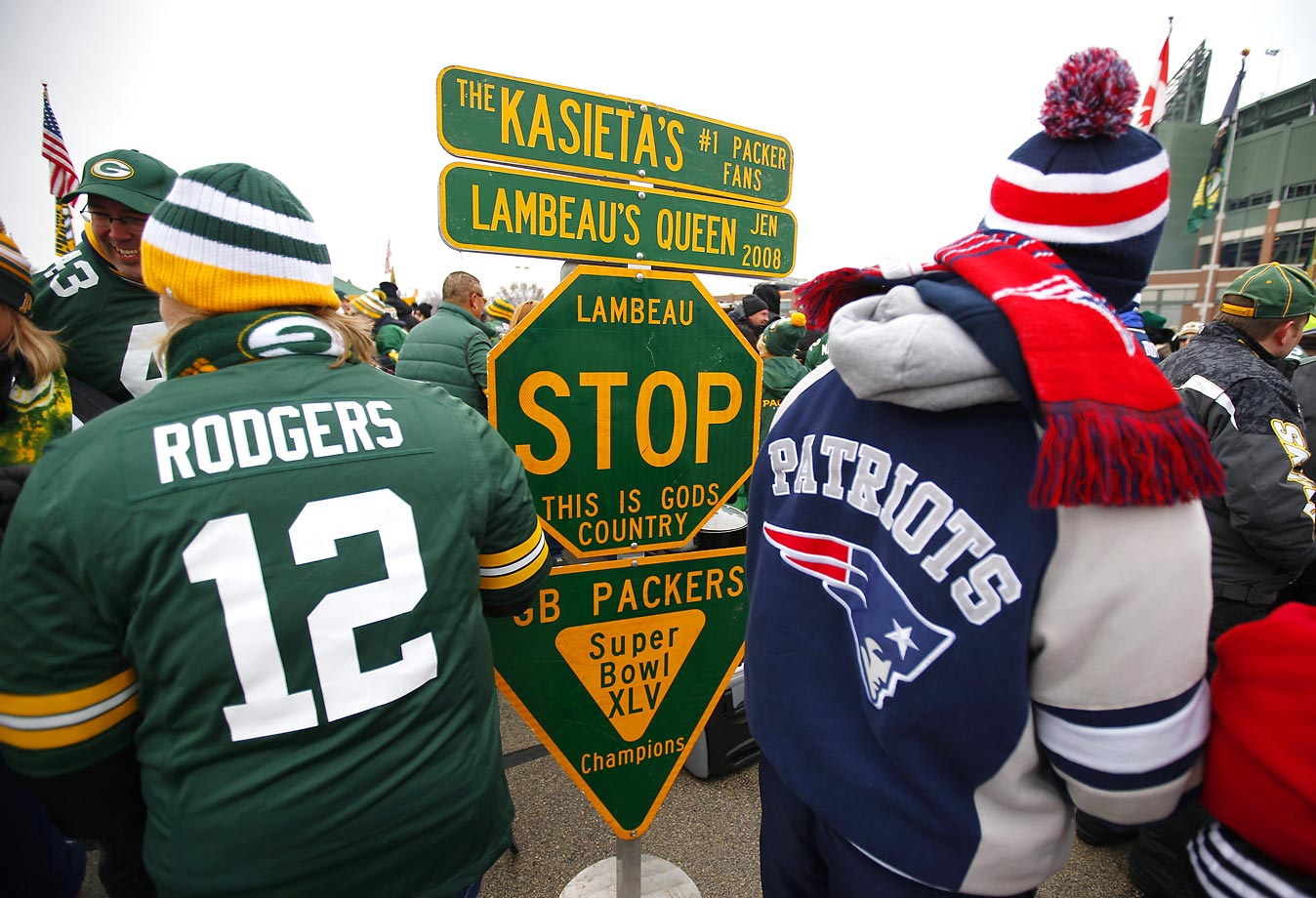 Fans tailgate in the parking lot of Lambeau Field before the Green Bay Packers play the New England Patriots.