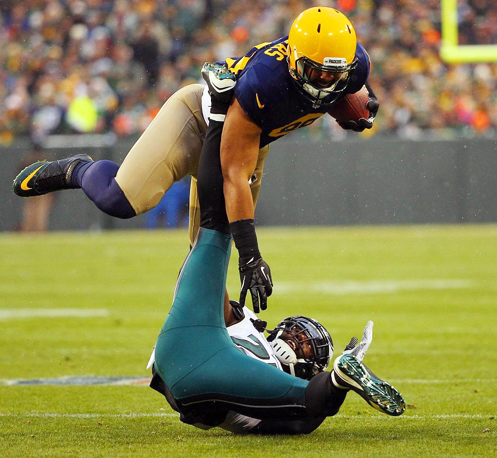 Eagles safety Malcolm Jenkins tries to bring down Packers tight end Richard Rodgers from the ground.