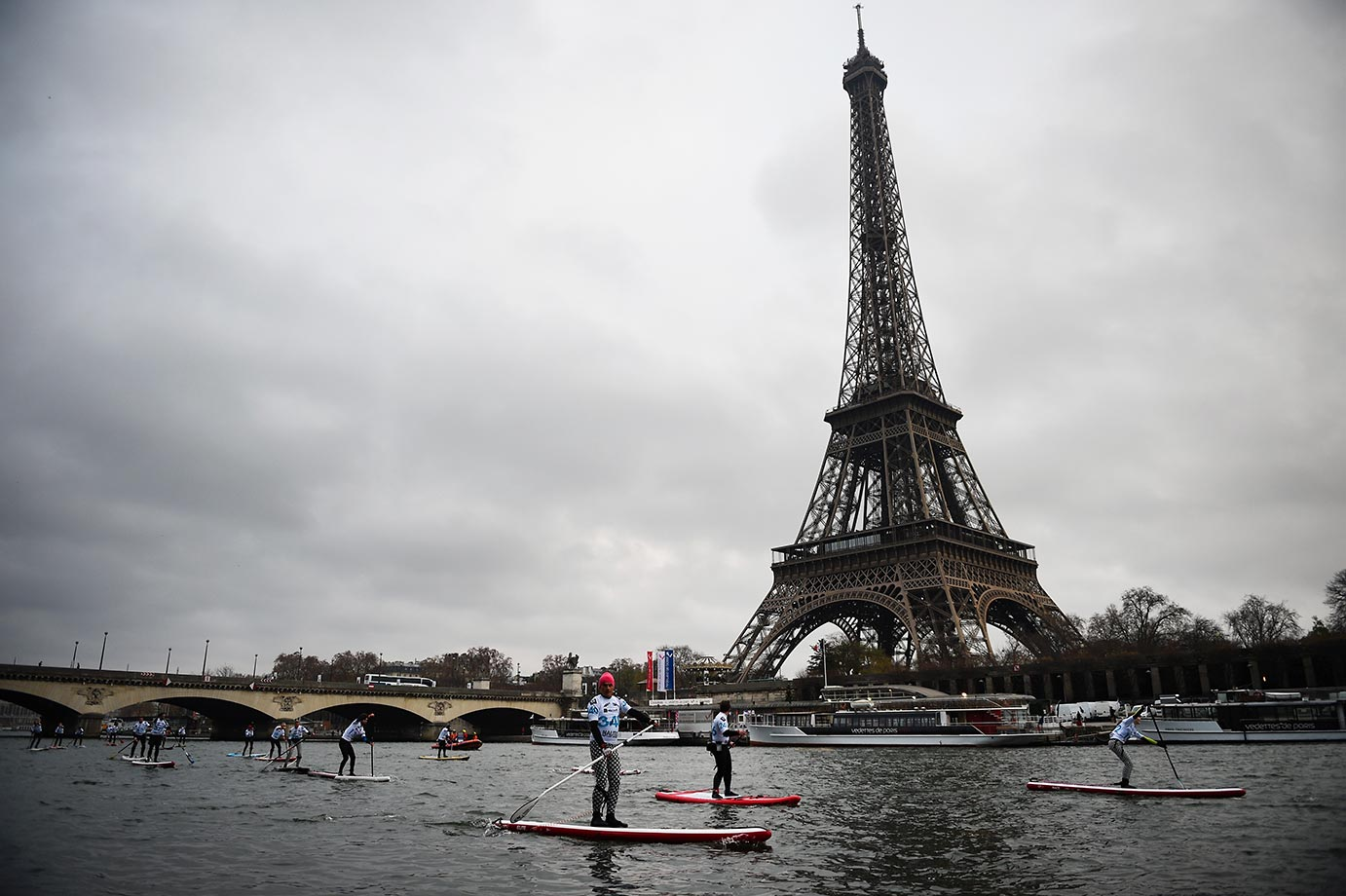A paddle board race on the River Siene goes past The Eiffel Tour.