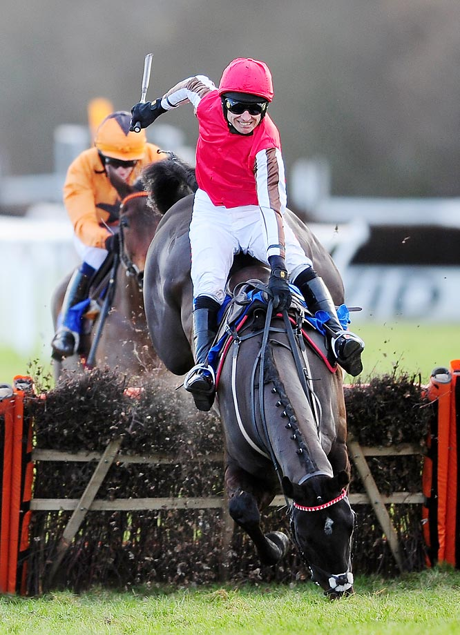 Paddy Brennan and Pitter Patter takes a spill at Exeter Racecourse in England.