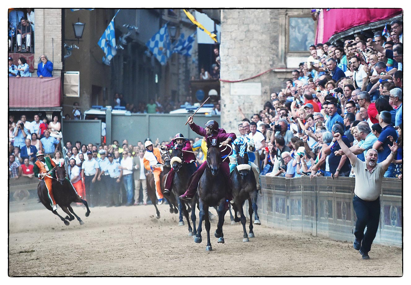 The Palio de Siena race — and a fan who should really find his seat.