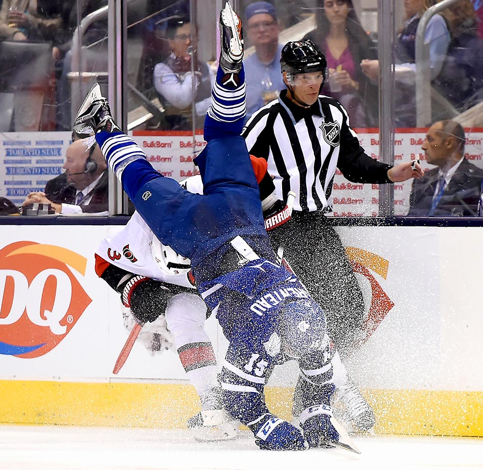 P.A. Parenteau of the Toronto Maple Leafs is upended by Marc Methot of the Senators.  It resulted in a two-minute penalty for Methot.
