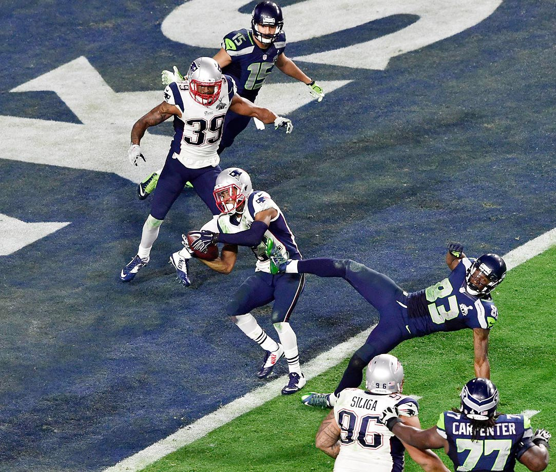 Just one yard away from a Super-Bowl-winning touchdown, the Seattle Seahawks bypassed Marshawn Lynch and opted to throw the ball on second down at the goal line. Patriots cornerback Malcolm Butler intercepted Russell Wilson with 26 seconds to play, sealing New England's first Super Bowl trophy in a decade. MVP honors went to Tom Brady, who threw for 328 yards and four touchdowns — including the game-winner — on his way to a fourth title, which tied him for most all-time for a quarterback. Brady and coach Bill Belichick faced controversy leading up to the Super Bowl amid allegations that they had deliberately deflated footballs to their advantage.                                      (Text credit: Alex Putterman/SI.com)