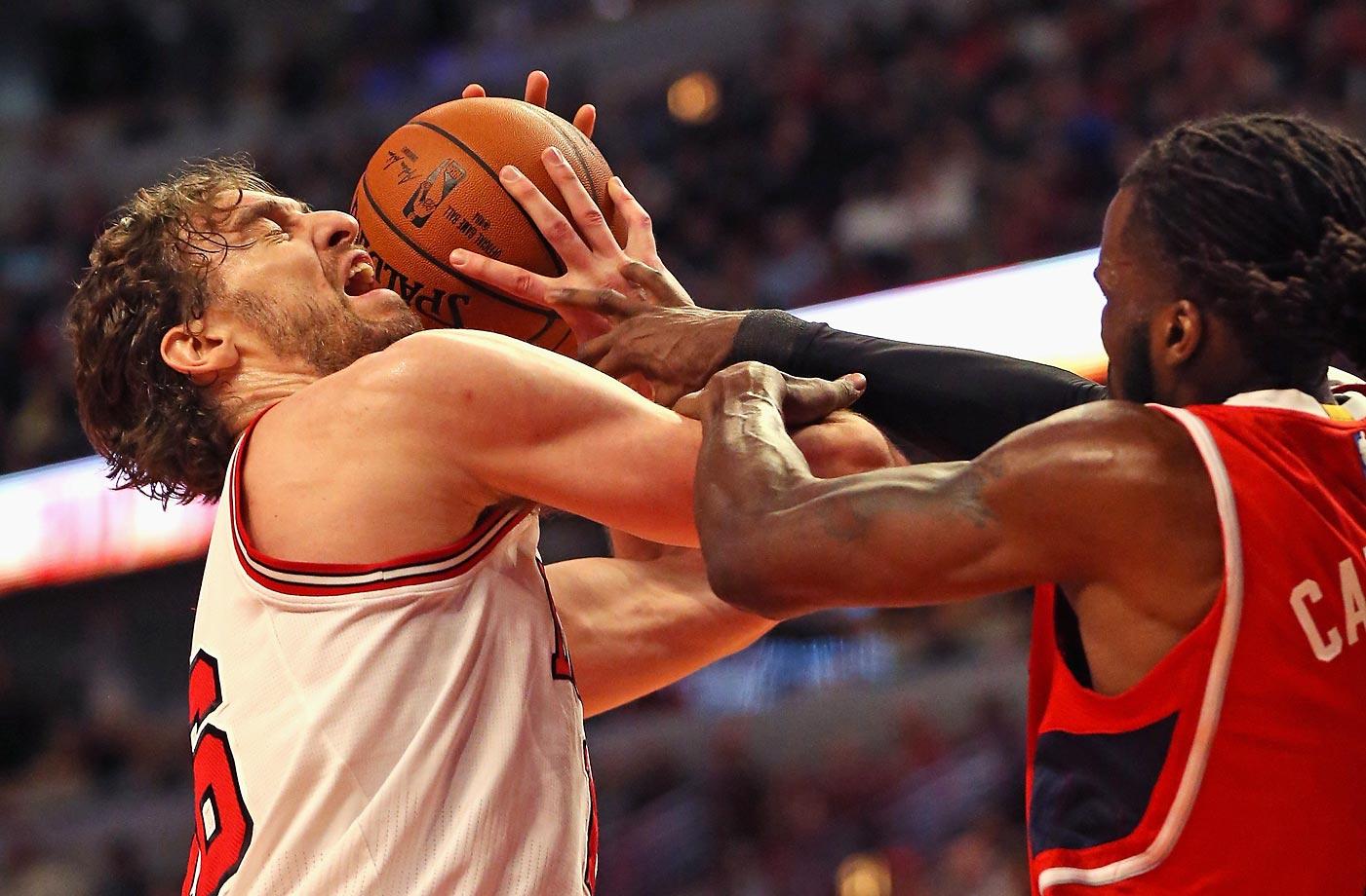 Pau Gasol is fouled by DeMarre Carroll of the Atlanta Hawks.
