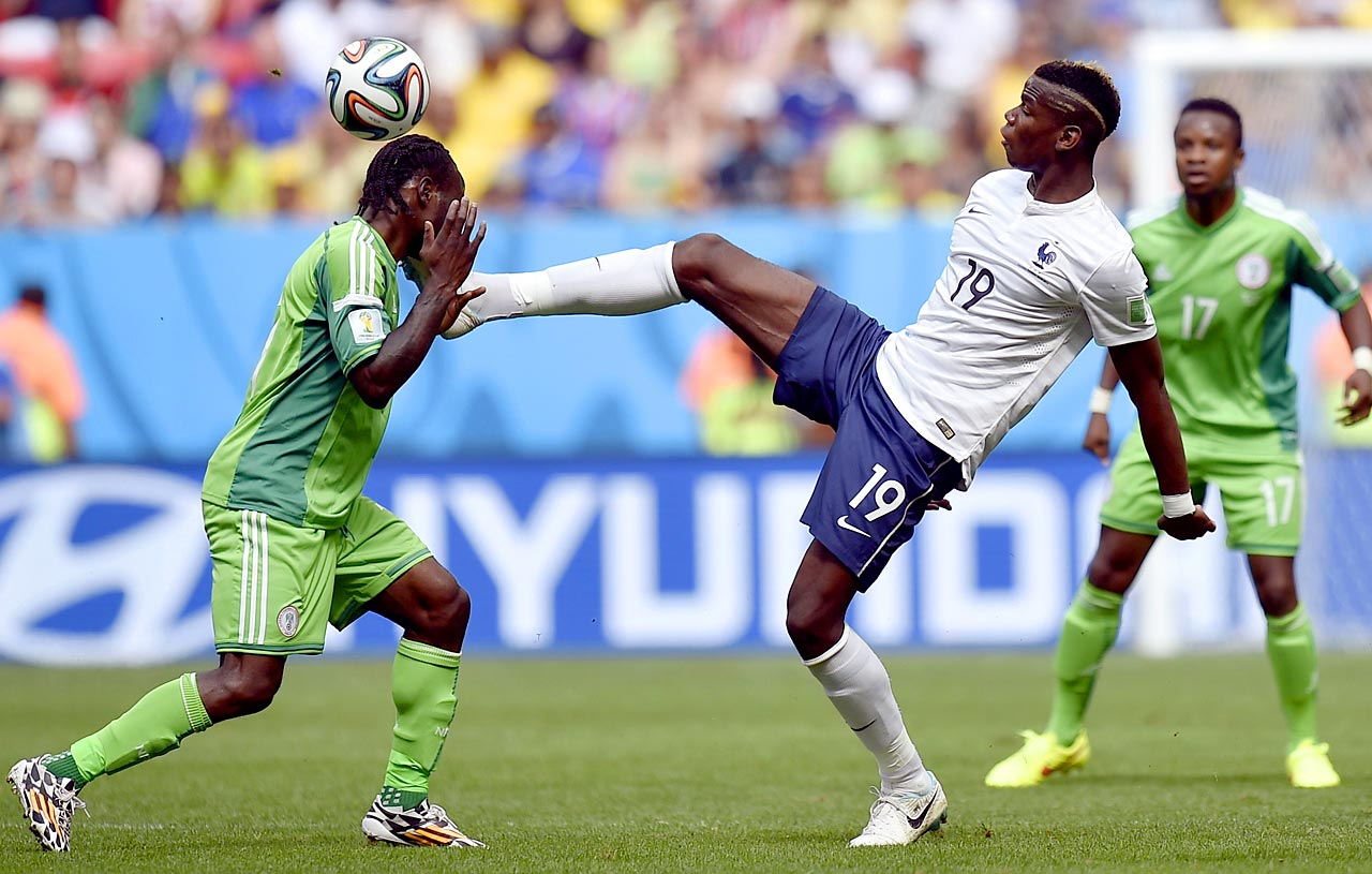 France's Paul Pogba (right) nearly kicks Victor Moses in the head during the World Cup Round of 16 match between France and Nigeria at the Estadio Nacional in Brasilia, Brazil.