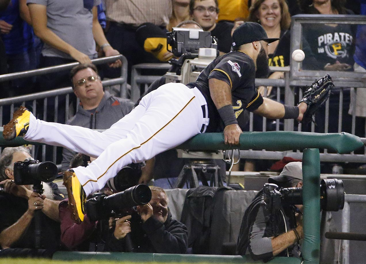 Pedro Alvarez of the Pittsburgh Pirates dives for a foul ball against the Chicago Cubs.