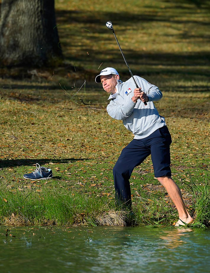 Peter Malnati swings out from the water on the 18th hole of the Web.com Tour Chitimacha Louisiana Open.