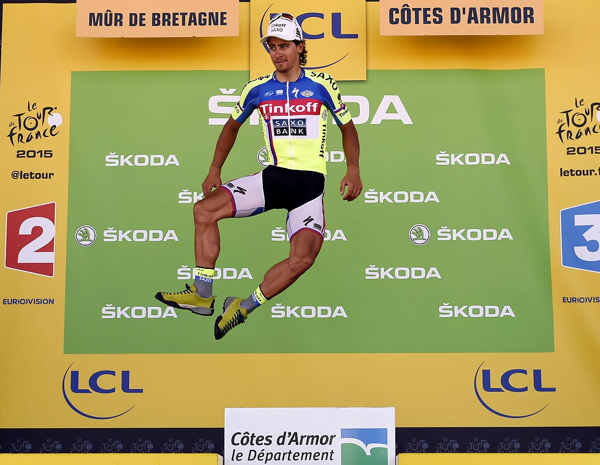 Peter Sagan of Slovakia jumps as he celebrates his green jersey of best sprinter at the end of the 181.5 km eighth stage of the Tour de France.