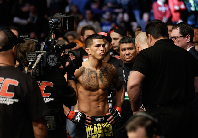 Anthony Pettis checks before fighting with Donald Cerrone during UFC Lightweight Championship on FOX 6 at the United Center in Chicago, Saturday, Jan. 26, 2013. Pettis won the bout.