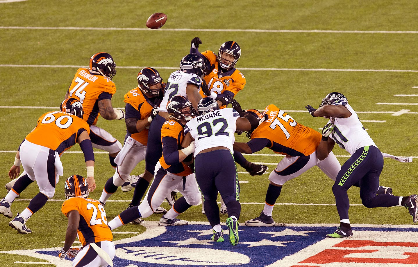 Michael Bennett of the Seahawks forces a Peyton Manning fumble in Super Bowl XLVIII in New Jersey.