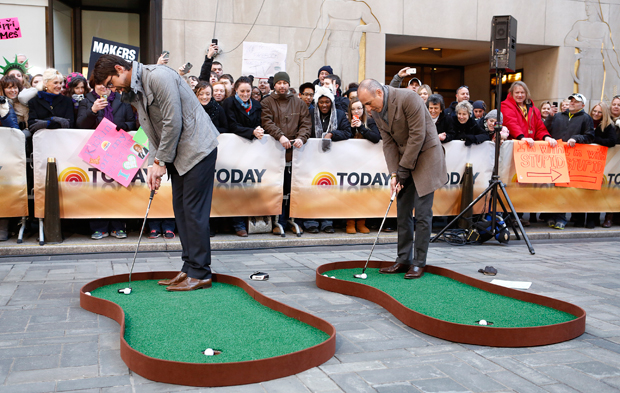 Michael Phelps and Matt Lauer work on their game in Feb. 2013. (Getty Images)