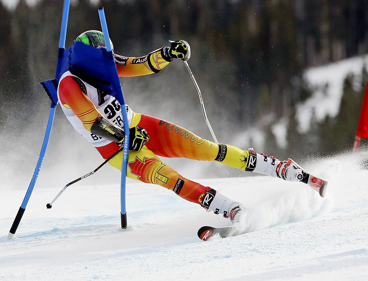 Phil Brown does a face-plant into a gate at the World Cup giant slalom on Sunday in Beaver Creek.
