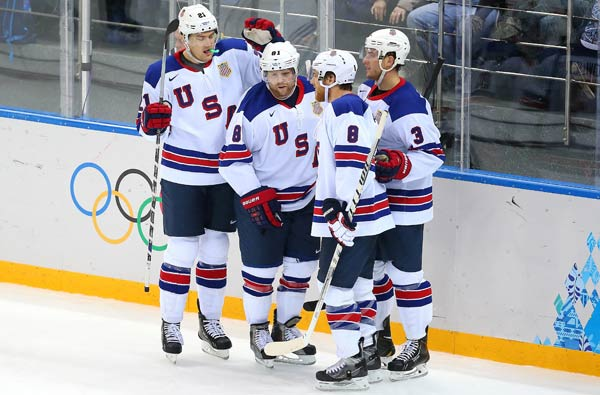Phil Kessel (second from left) rung up a natural hat trick that launched Team USA's rout.