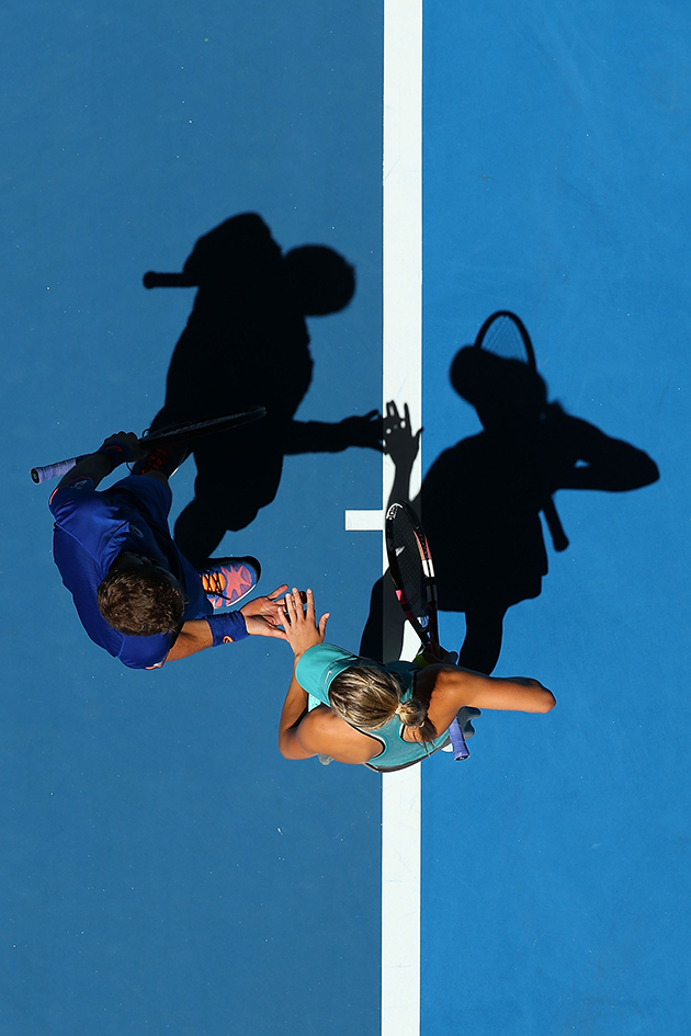 Vasek Pospisil and Eugenie Bouchard of Canada celebrate a point in the mixed doubles match against Fabio Fognini and Flavia Pennetta at Hopman Cup.