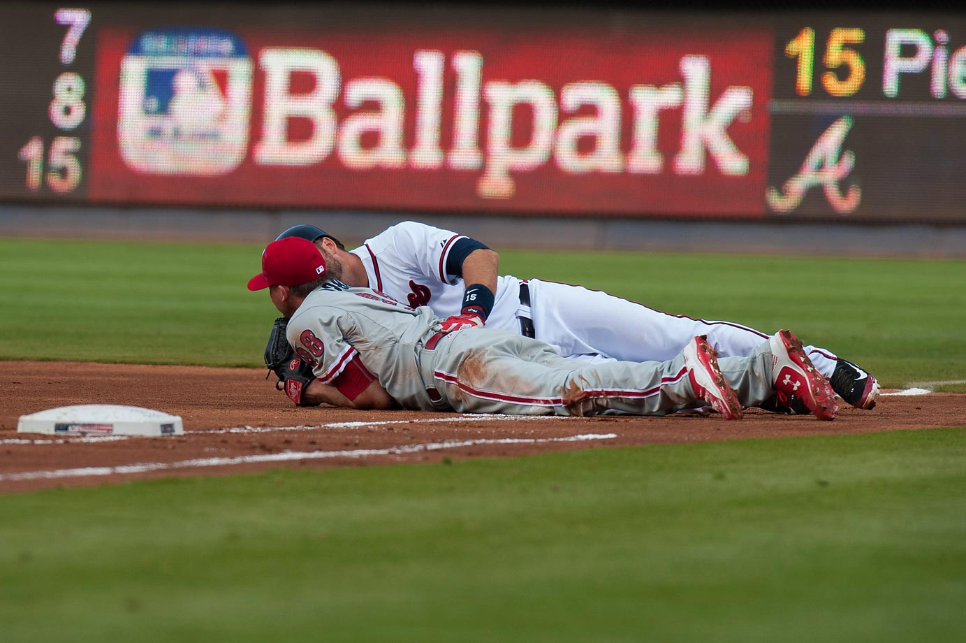 A.J. Pierzynski of the Atlanta Braves and Kevin Correia of the Philadelphia Phillies after their collision at first base.