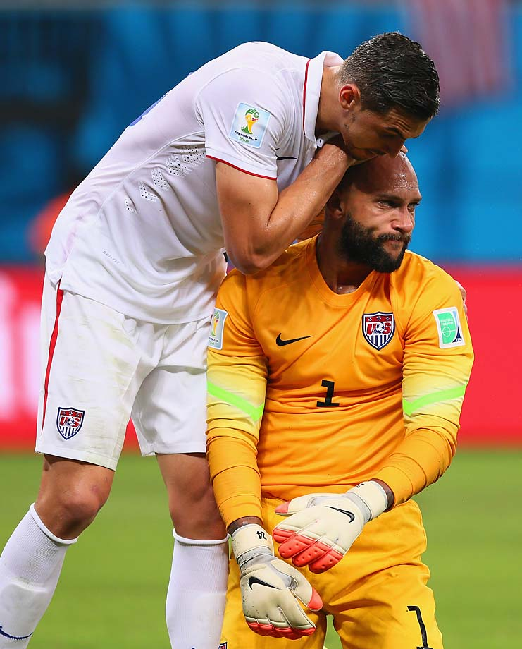 A teammate congratulates Tim Howard for his back-to-back first-half saves, but the goaltender was upset with himself for mishandling the ball on the first one.