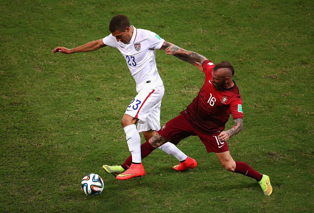 Fabian Johnson of the United States is challenged by Raul Meireles of Portugal.