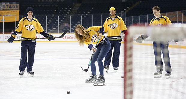 Kate Bock hits the ice with Roman Josi, Filip Forsberg and Seth Jones of the Nashville Predators