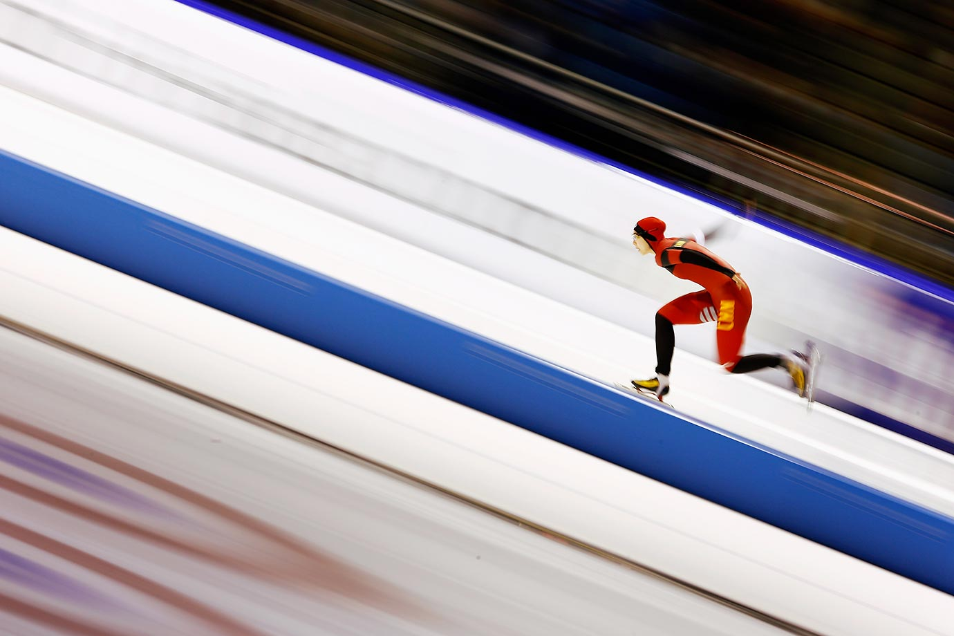 Qishi Li of China competes in the 1000m race during the ISU World Cup Speed Skating.