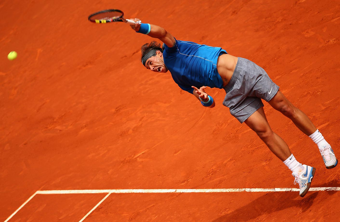 Rafael Nadal serves against Juan Monaco of Argentina in their second round match of the Mutua Madrid Open.