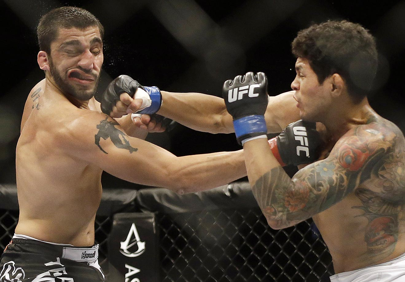Diego Ferreira (right) lands a punch on Ramsey Nijem during the second round of their lightweight mixed martial arts bout. Ferreira won in the second round.