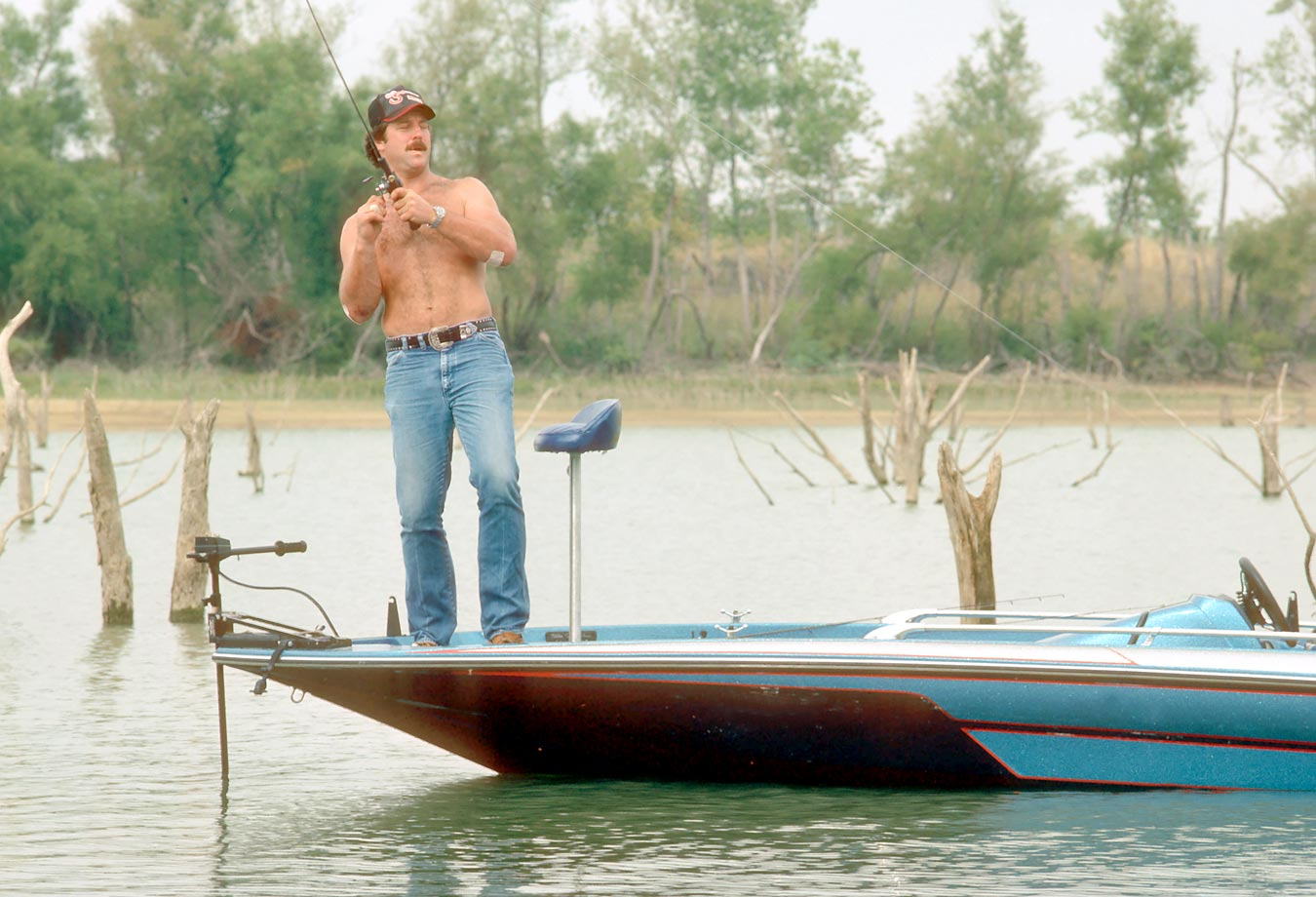 Randy White of Dallas Cowboys fishing for bass in Landenberg, Penn., in 1984.