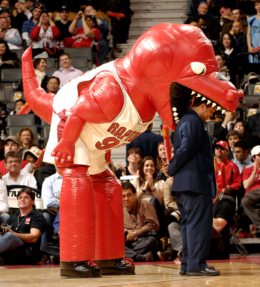 The Raptor devours an usher during a game between Toronto and Miami.