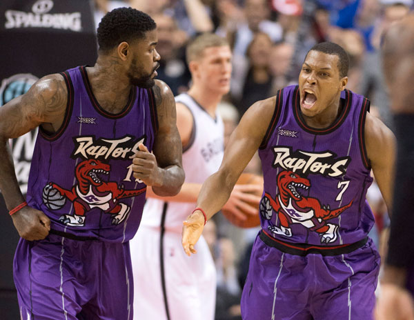 Amir Johnson and Kyle Lowry :: AP