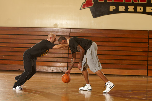 New York Knicks forward Carmelo Anthony works out with NBA trainer Idan Ravin in the gym at Fairfax Senior High School in Los Angeles, CA.