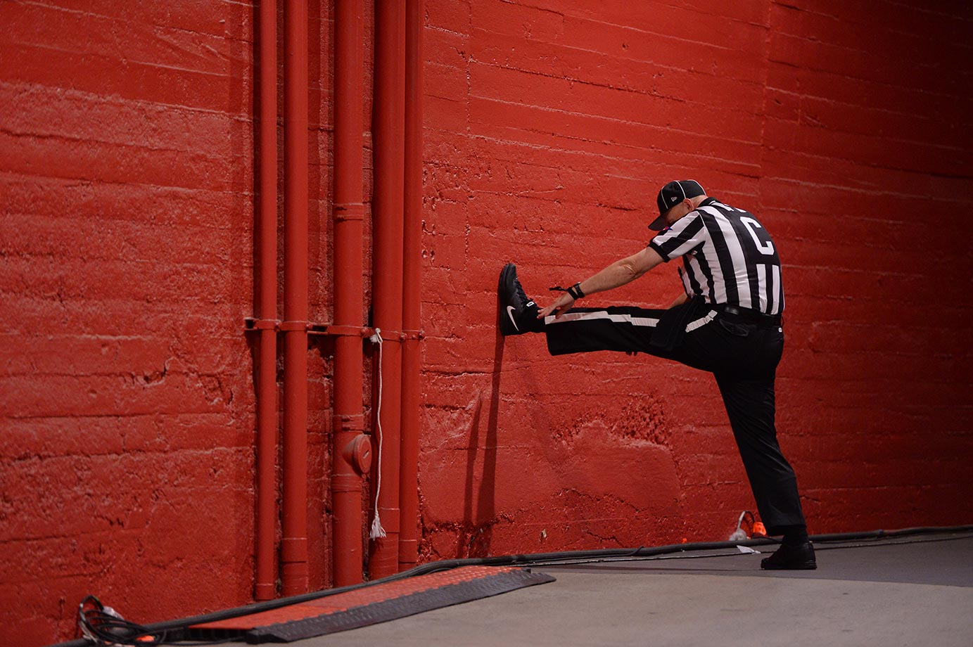A referee does a little stretching before the game between Arkansas State and USC.