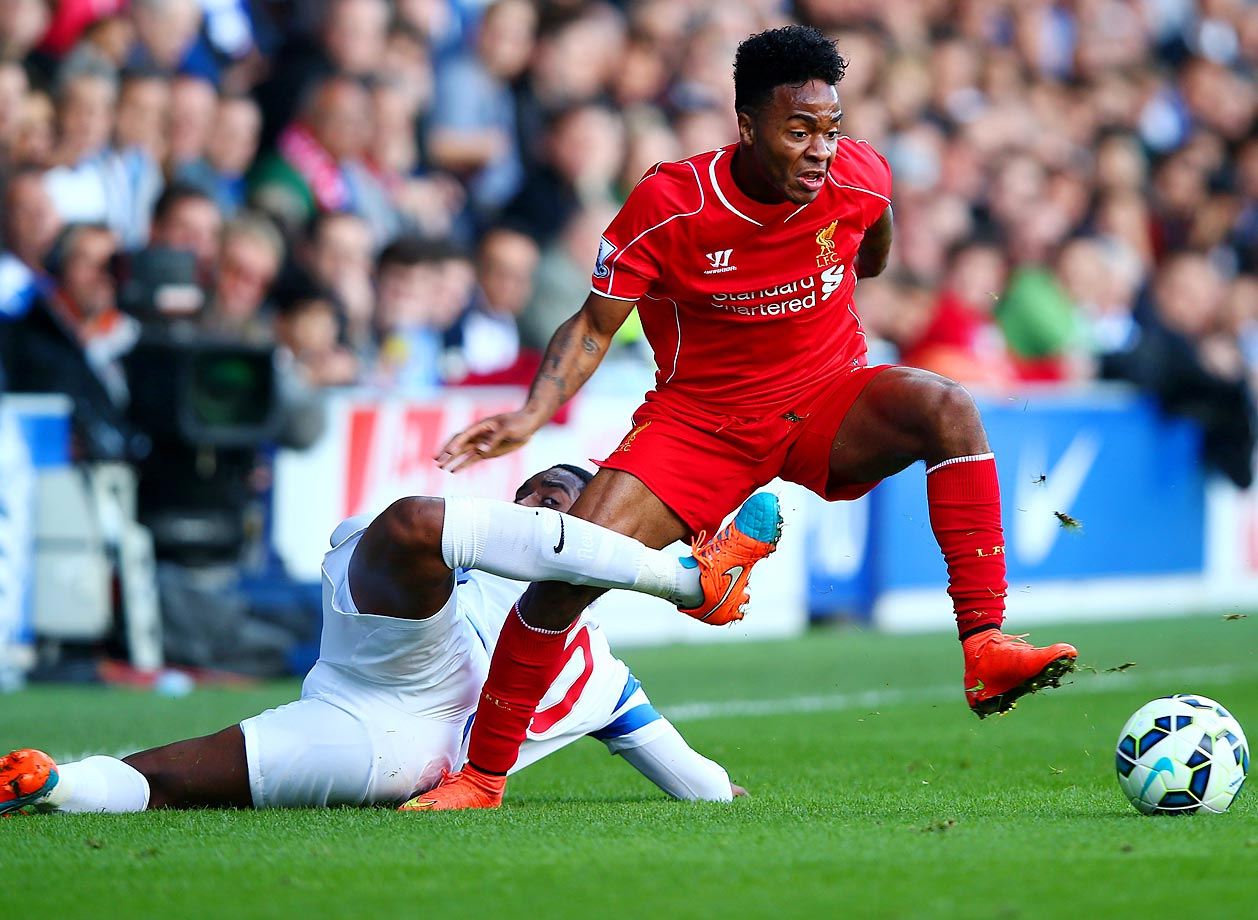 Raheem Sterling of Liverpool fights for the ball with Leroy Fer of QPR during the Barclays Premier League match between Queens Park Rangers and Liverpool.