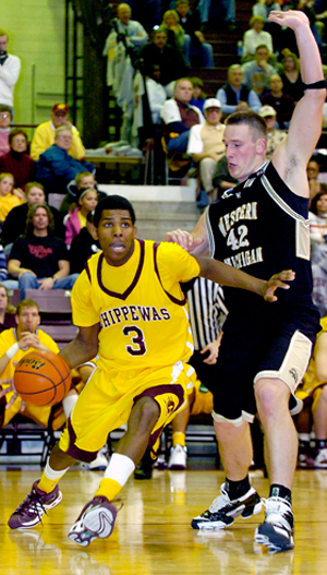 Central Michigan University's Jeremy Allen, left, drives past Western Michigan University's Joe Reitz during a game in Rose Arena in 2008.