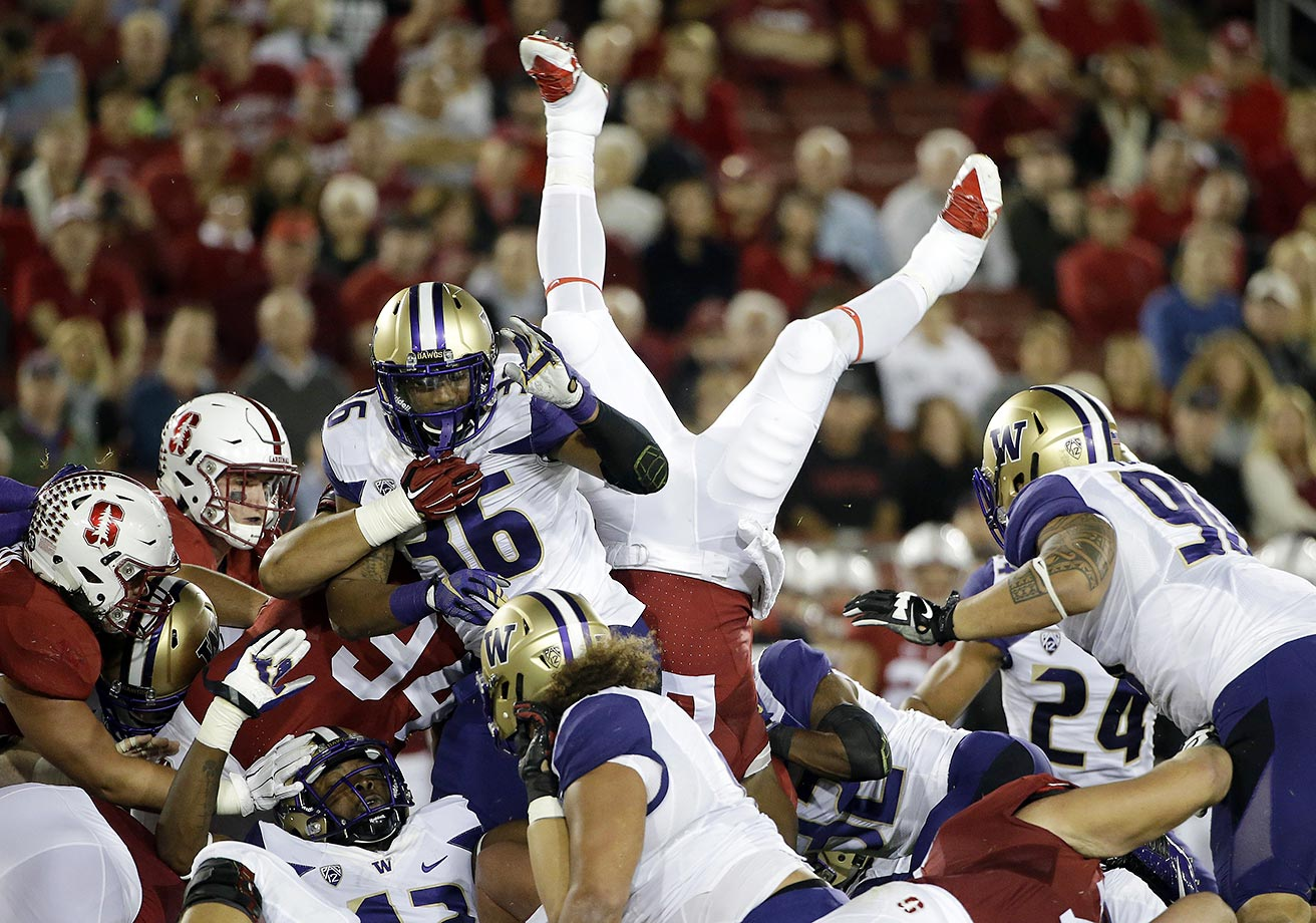 Remound Wright of Stanford is upended during a game against Washington.