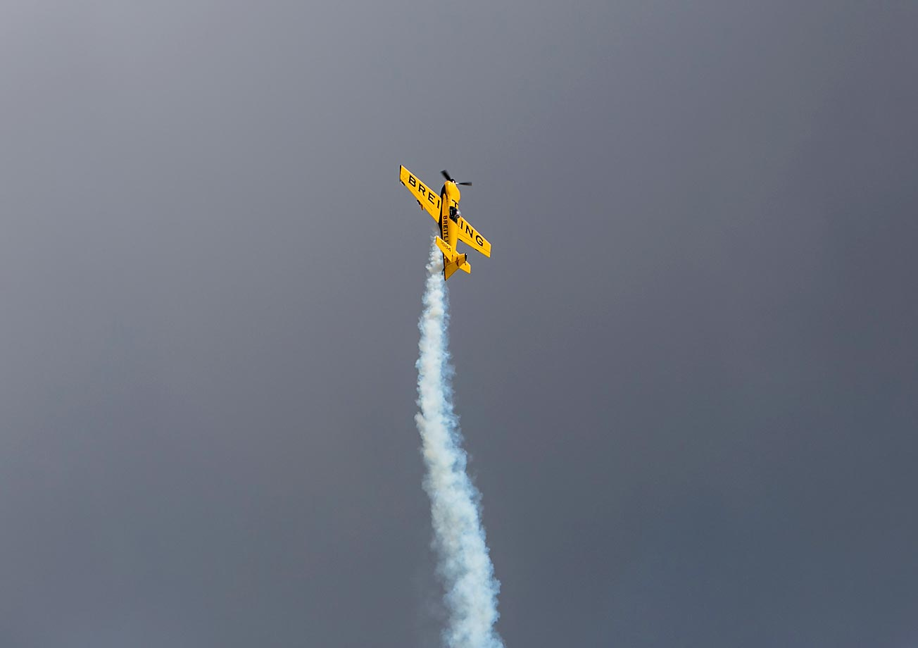 The Breitling stunt plane performs.