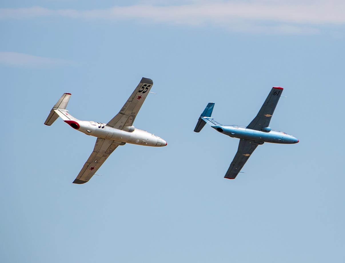 Two jets fly around the course at the Reno National Championship Air Races.