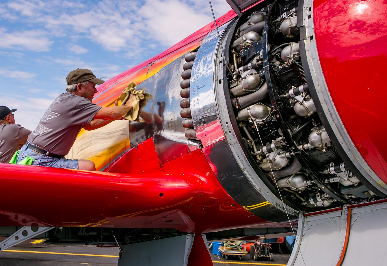 A man cleans his airplane in preparation for the 2013 races.