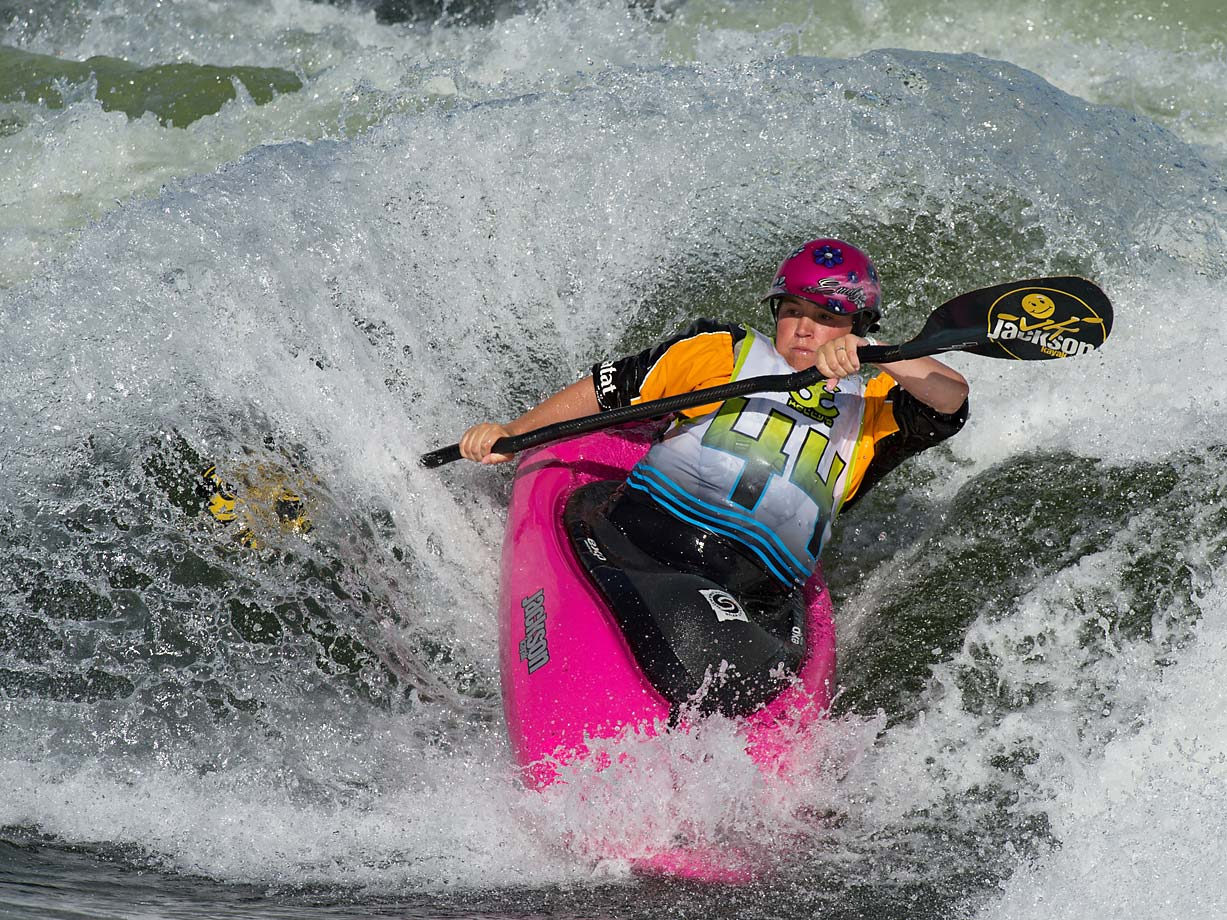The 2014 Payette River Games women's freestyle champion Emily Jackson kicking up a huge spray.