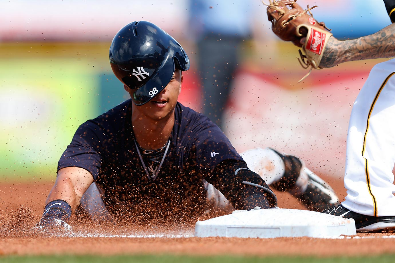 Rob Refsnyder of the Yankees gets tagged out while trying to reach third base during a spring training game against the Pittsburgh Pirates.