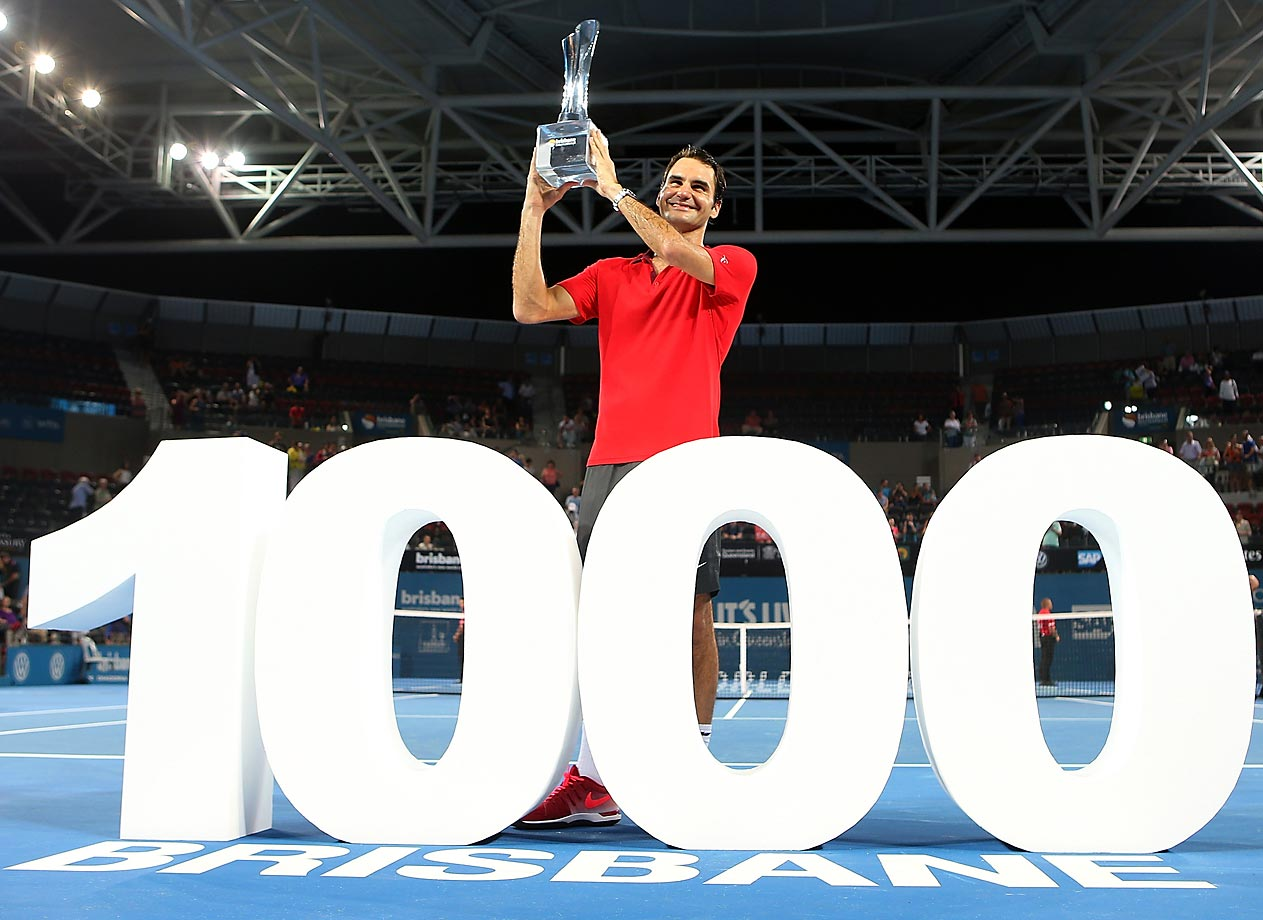 Roger Federer holds the Roy Emerson trophy after winning his 1,000th singles title after the final match against Milos Raonic of Canada at the 2015 Brisbane International.