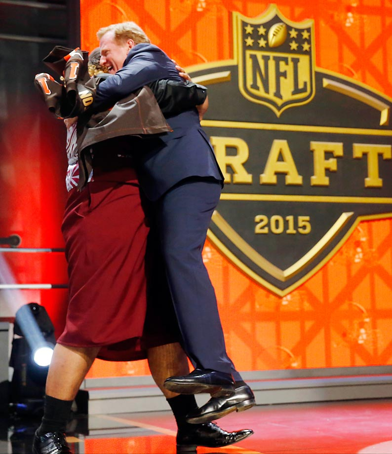 Roger Goodell is in the air again, this time lifted by Washington defensive lineman Danny Shelton as he celebrates being selected by the Cleveland Browns as the 12th pick in the first round.