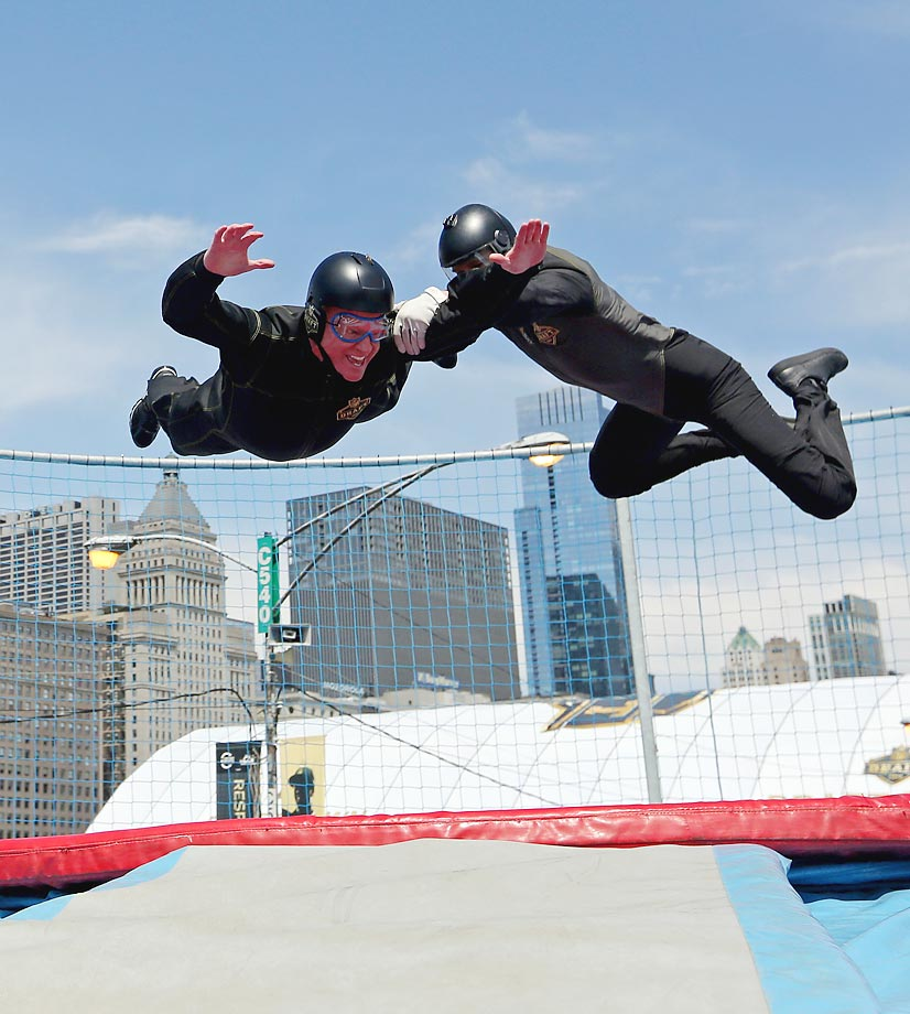 """Commissioner Roger Goodell tries out the """"Sweetness Simulator"""" skydiving simulator in Draft Town."""