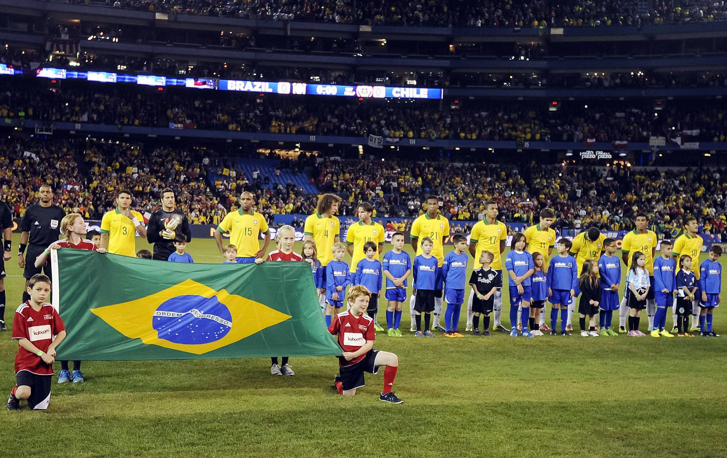 The Brazil team on the field before playing Chile at Rogers Centre in Toronto on Nov. 19, 2013.