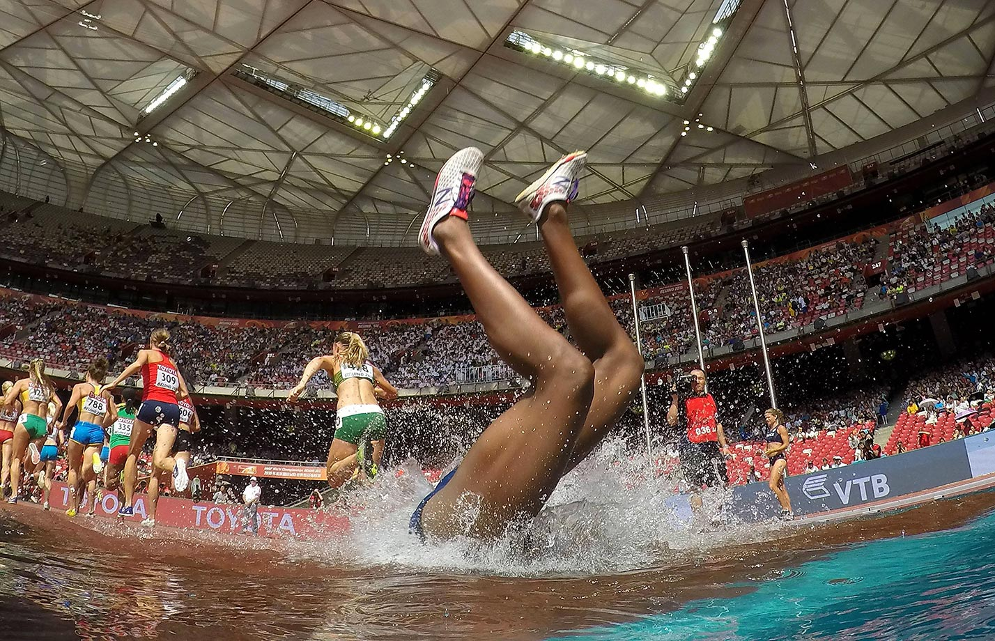 Rolanda Bell falls into the water during the 3,000 meter steeplechase at the 2015 IAAF World Championships in Beijing.