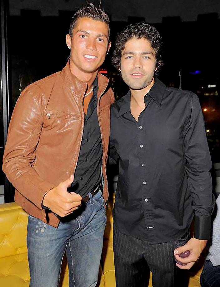 Cristiano Ronaldo and Adrian Grenier strike a pose during a party in Hollywood.