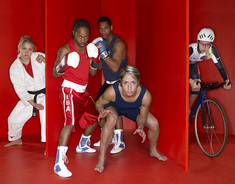 Ronda Rousey (far left) in a Summer Olympics preview portrait with Rau'shee Warren (boxing), Demetrius Andrade (boxing), Marci Van Dusen (freestyle wrestling), and Sarah Hammer (cycling).