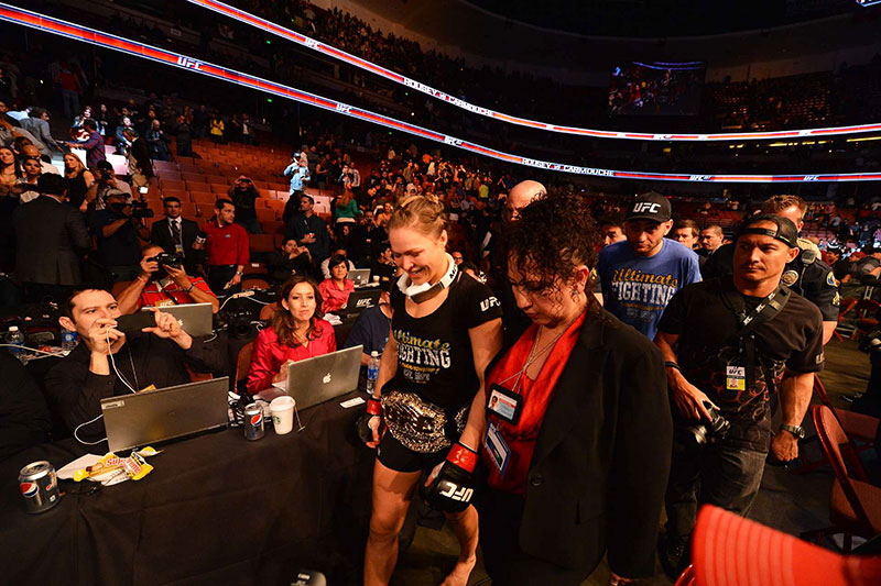 Ronda Rousey walks out victorious after her fight against Liz Carmouche during the inagural Women's UFC fight at Honda Center in Anaheim, CA.