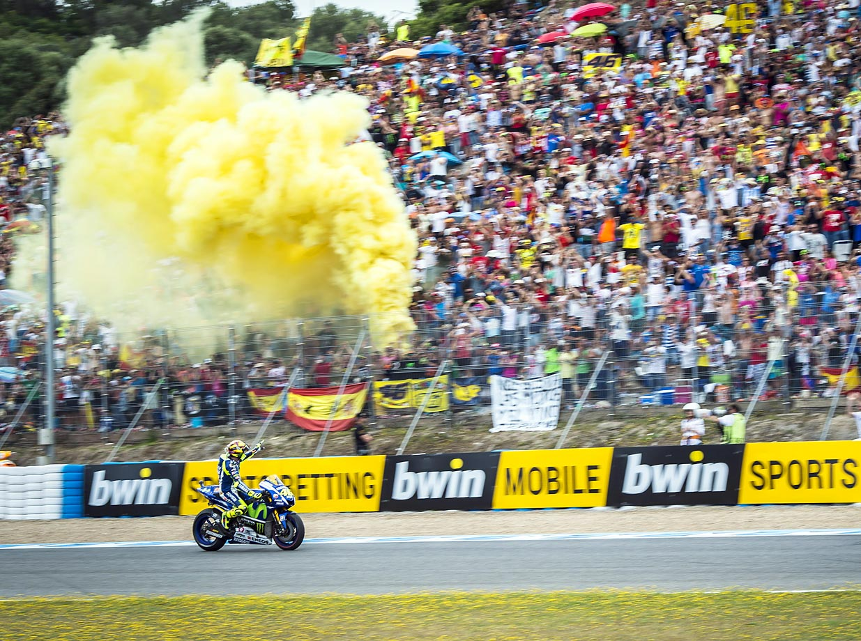 Rossi Valentino rides by fans during the Moto GP race at Gran Premio de Espana in Spain.