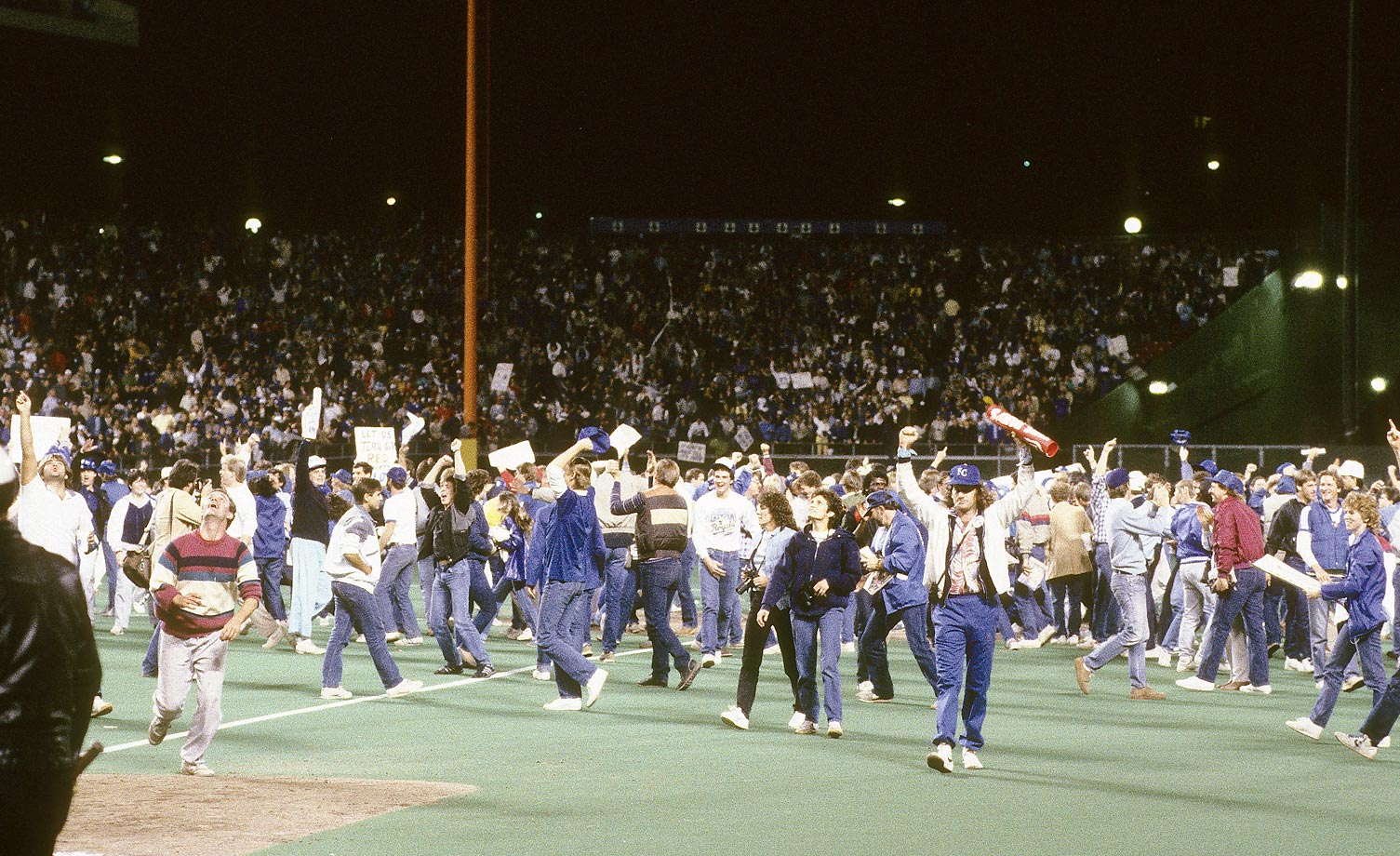 Royals fans rush the field after the Royals defeated the Cardinals in Game 7.