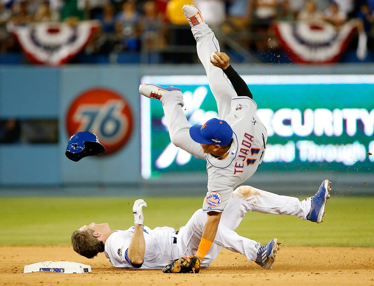 Ruben Tejada of the Mets gets hit by Chase Utley of the Dodgers in the seventh inning of the NLDS, resulting in a broken leg for Tejada and a two-game suspension for Utley.