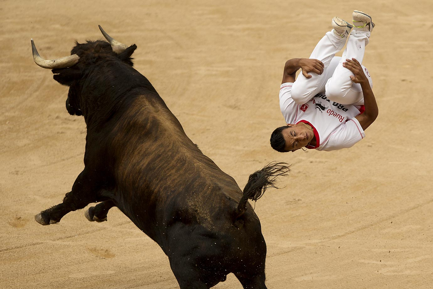 A ''recortador'' jumps over a bull during a competition at the San Fermin festival in Pamplona, Spain.
